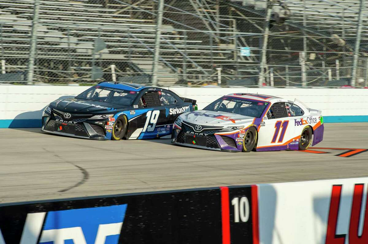 Martin Truex Jr. (19) and Denny Hamlin (11) drive during the NASCAR Cup Series auto race at Dover International Speedway, Saturday, Aug. 22, 2020, in Dover, Del. (AP Photo/Jason Minto)