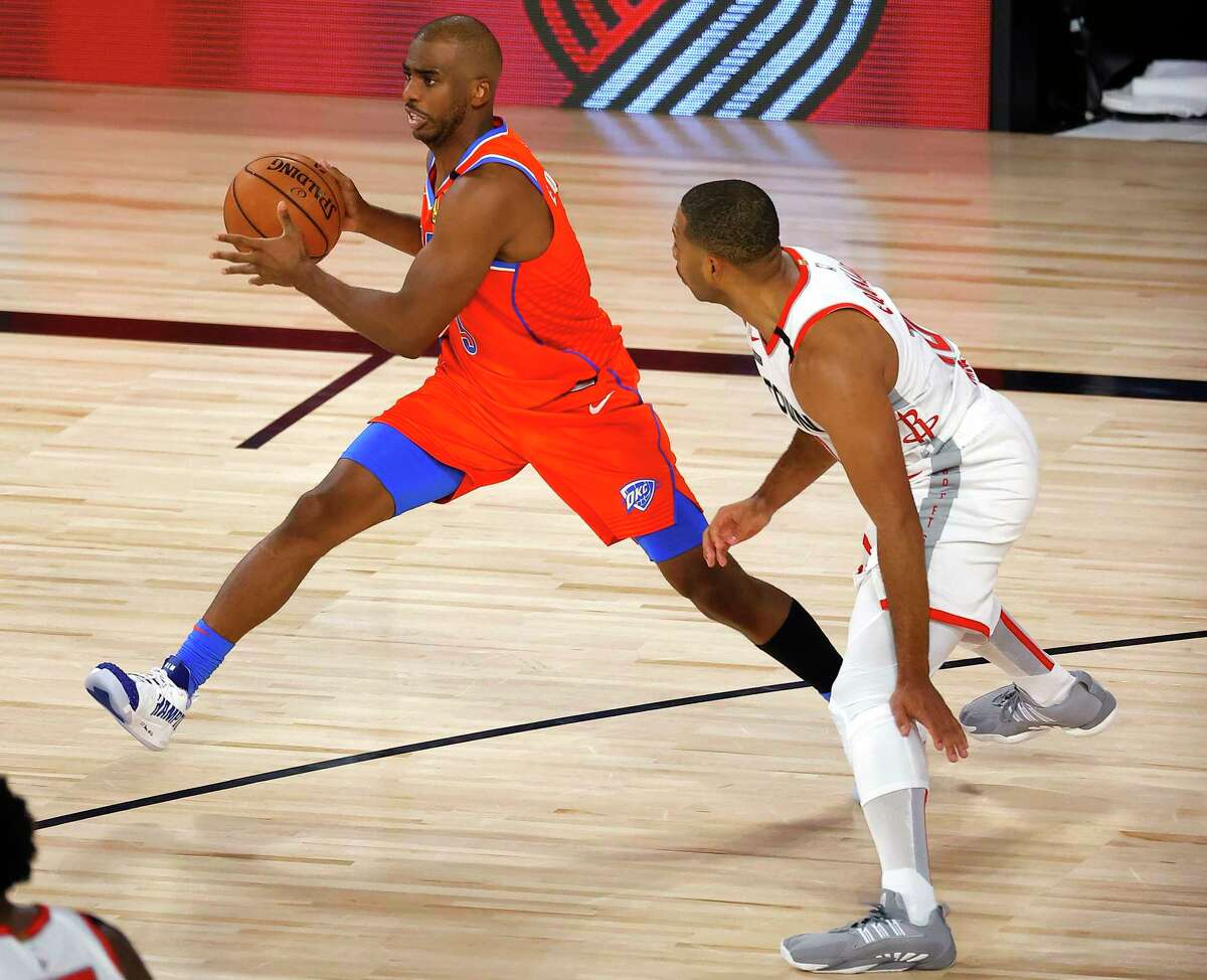 Oklahoma City Thunder's Chris Paul looks to pass the ball as Houston Rockets' Eric Gordon defends during the third quarter of Game 3 of an NBA basketball first-round playoff series, Saturday, Aug. 22, 2020, in Lake Buena Vista, Fla. (Mike Ehrmann/Pool Photo via AP)