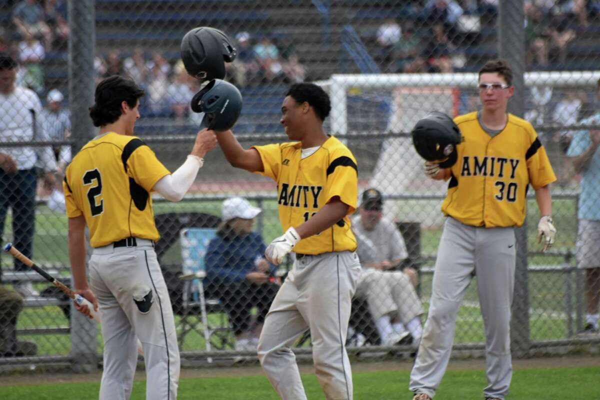 """Amity's Julian """"JuJu"""" Stevens celebrates after hitting a home run in the 2019 SCC Championship game in West Haven."""