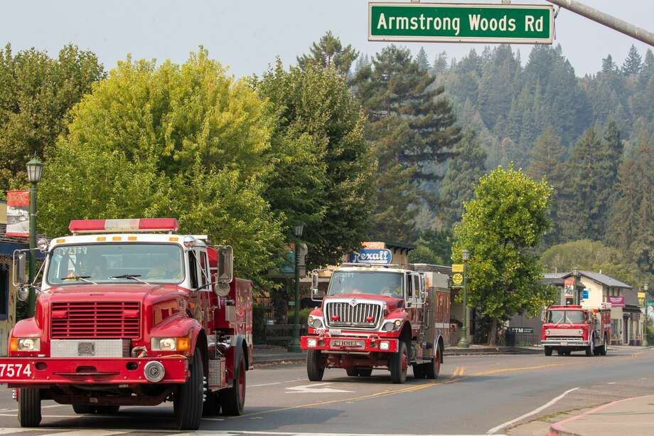 Firefighters from different cities drive through downtown Guerneville, Calif., during a mandatory evacuation as the LNU Lightning Complex fire continues to burn regions of Solano and Napa counties on Saturday, Aug., 22, 2020. (Photo by Ray Chavez/MediaNews Group/The Mercury News via Getty Images) Photo: MediaNews Group/The Mercury News/MediaNews Group Via Getty Images / Bay Area News Group