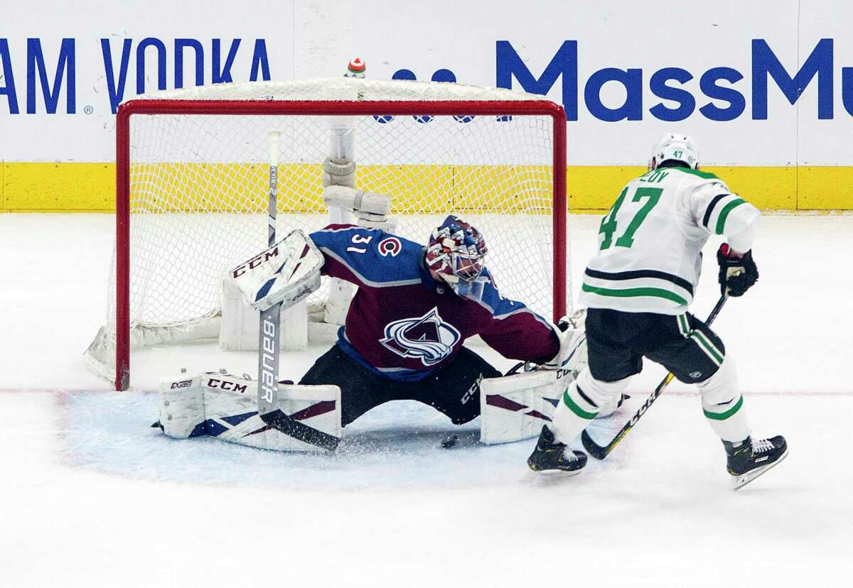 Colorado Avalanche goalie Philipp Grubauer (31) is scored against by Dallas Stars' Alexander Radulov (47) during first-period NHL Western Conference Stanley Cup playoff hockey game action in Edmonton, Alberta, Saturday, Aug. 22, 2020. (Jason Franson/The Canadian Press via AP)