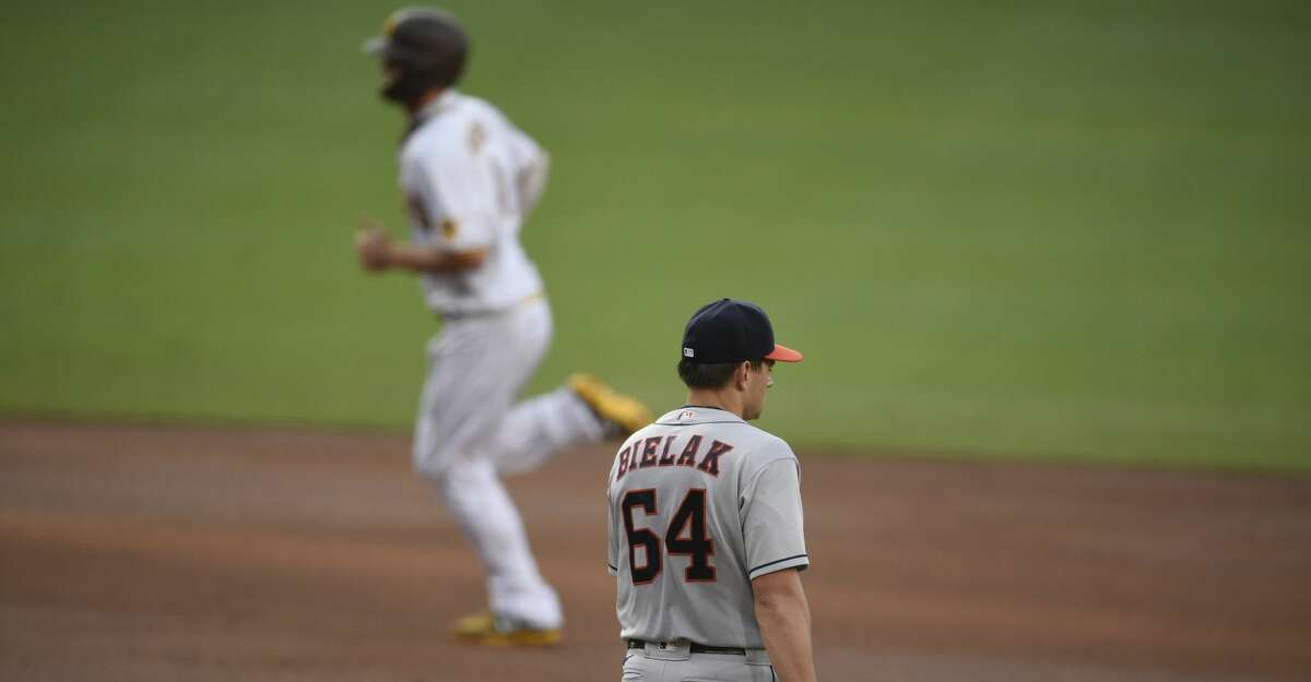Houston Astros starting pitcher Brandon Bielak, right, walks back to the mound after allowing a solo home run to San Diego Padres' Wil Myers during the second inning of a baseball game in San Diego, Saturday, Aug. 22, 2020. (AP Photo/Kelvin Kuo)