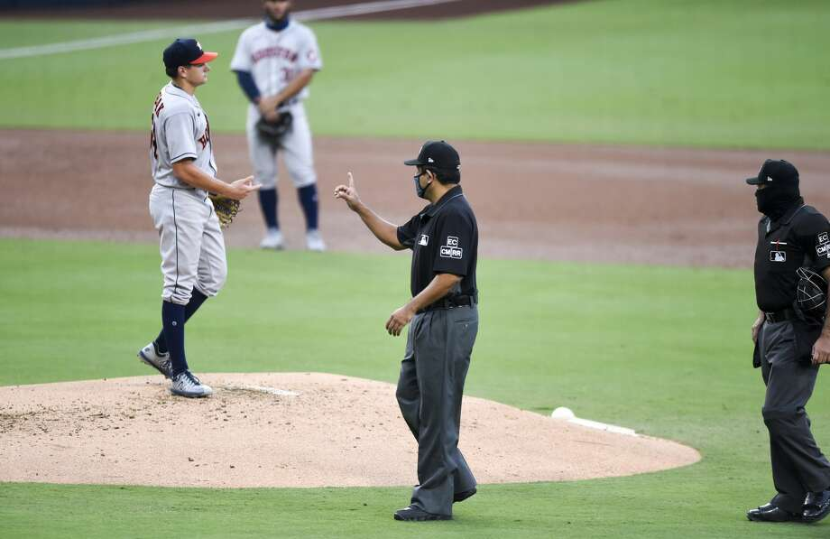 SAN DIEGO, CA - AUGUST 22: Umpire Alfonso Márquez signals next to Brandon Bielak #64 of the Houston Astros after Fernando Tatis Jr. #23 of the San Diego Padres was hit by a pitch during the second inning of a baseball game at Petco Park on August 22, 2020 in San Diego, California. (Photo by Denis Poroy/Getty Images) Photo: Denis Poroy/Getty Images / 2020 Getty Images