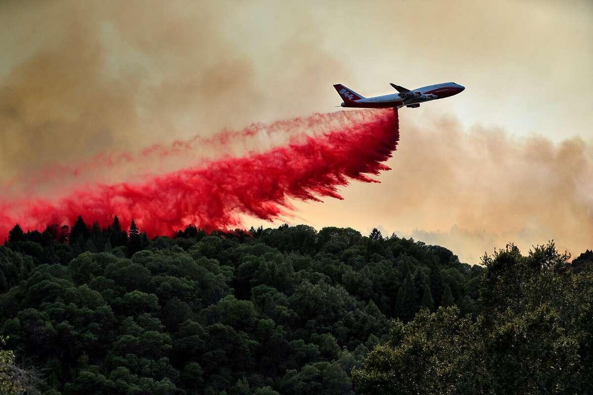 The CDF 747 Global Supertanker drops fire retardant on the Walbridge Fire near Mountain View Ridge Road west of Healdsburg, Calif., on Friday, August 21, 2020.