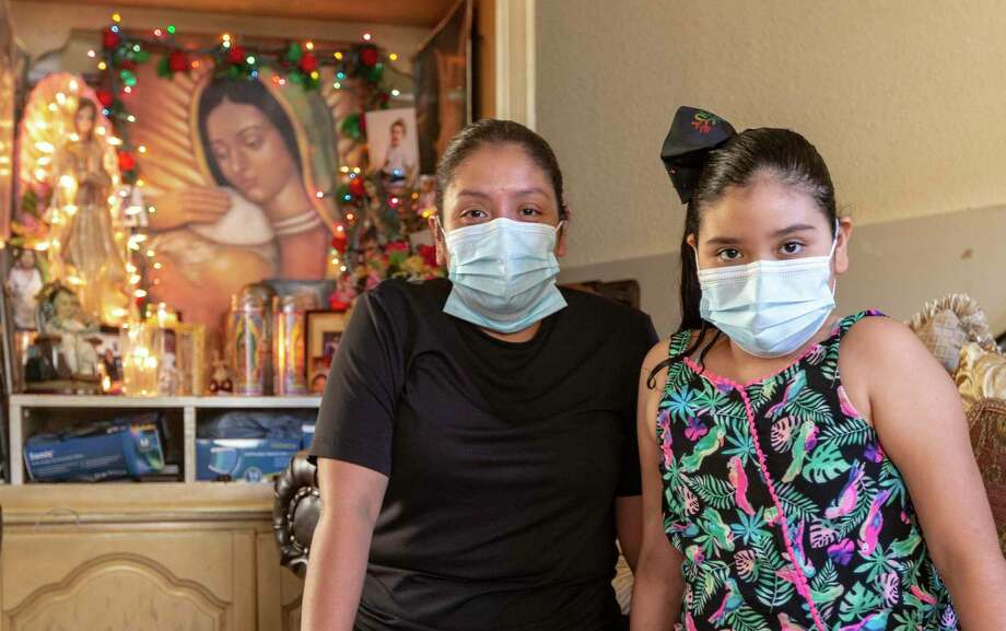 Makayla Rodriguez, right, developed COVID-19 after being exposed to the coronavirus and recently was released from a hospital in San Antonio after recovering. Her mother, San Juana Rios, poses with her in their home in Laredo on Tuesday, Aug. 20, 2020. Photo: William Luther /Staff Photographer / ©2020 San Antonio Express-News