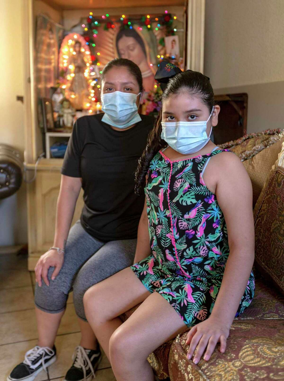 """San Juana Rios, left, said it infuriates her when she sees people gathering in large crowds, increasing the chances of spreading the coronavirus. Maybe if one of their children ended up in the hospital they would finally """"get it,"""" she said, sitting with her daughter, Makayla Rodriquez."""