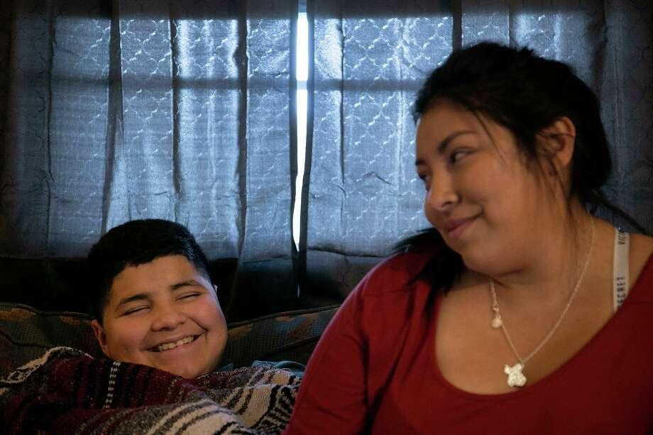 Zenaida Jeana Tijerina spends time with her son, Derrin Herrera, 11, at their home in Poteet on Wednesday, Aug. 19, 2020. Jeana and her children all had COVID-19. Photo: Lisa Krantz /Staff Photographer / San Antonio Express-News