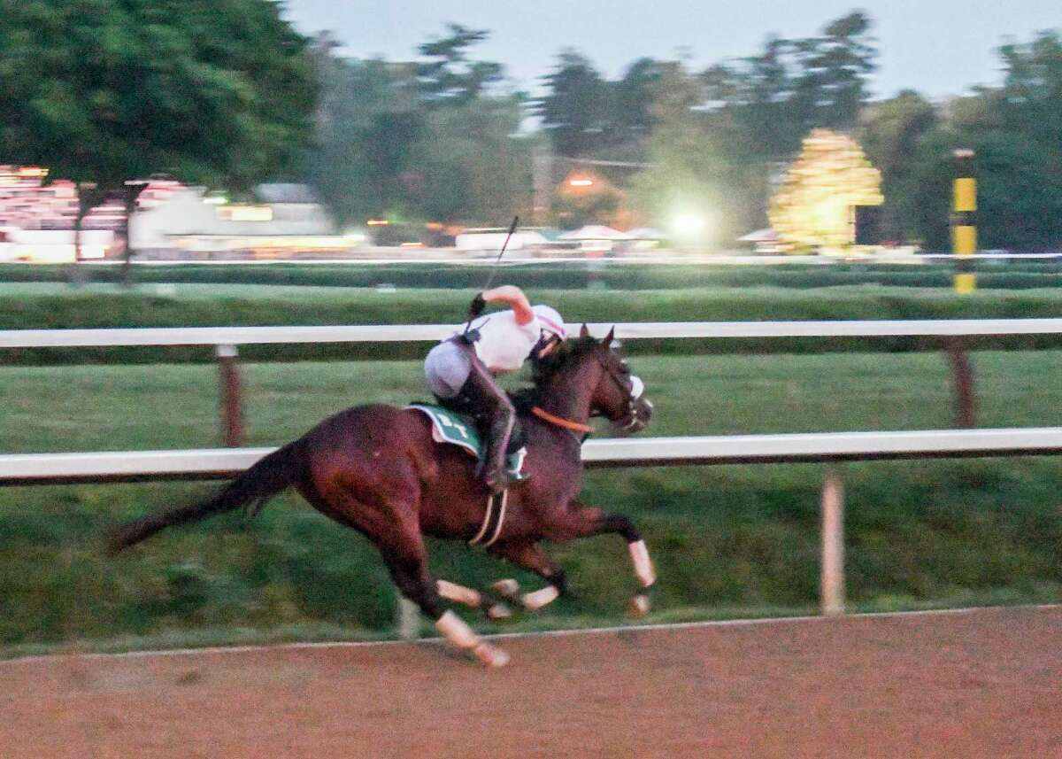 In the predawn hours where only the illumination from street lamps bathed the track Tiz the Law with exercise rider Heather Smullen aboard had one of his final preparatory works before the Kentucky Derby Sunday Aug.23, 2020 at the Saratoga Race Course in Saratoga Springs, N.Y. Photo by Skip Dickstein/Special to the Times Union