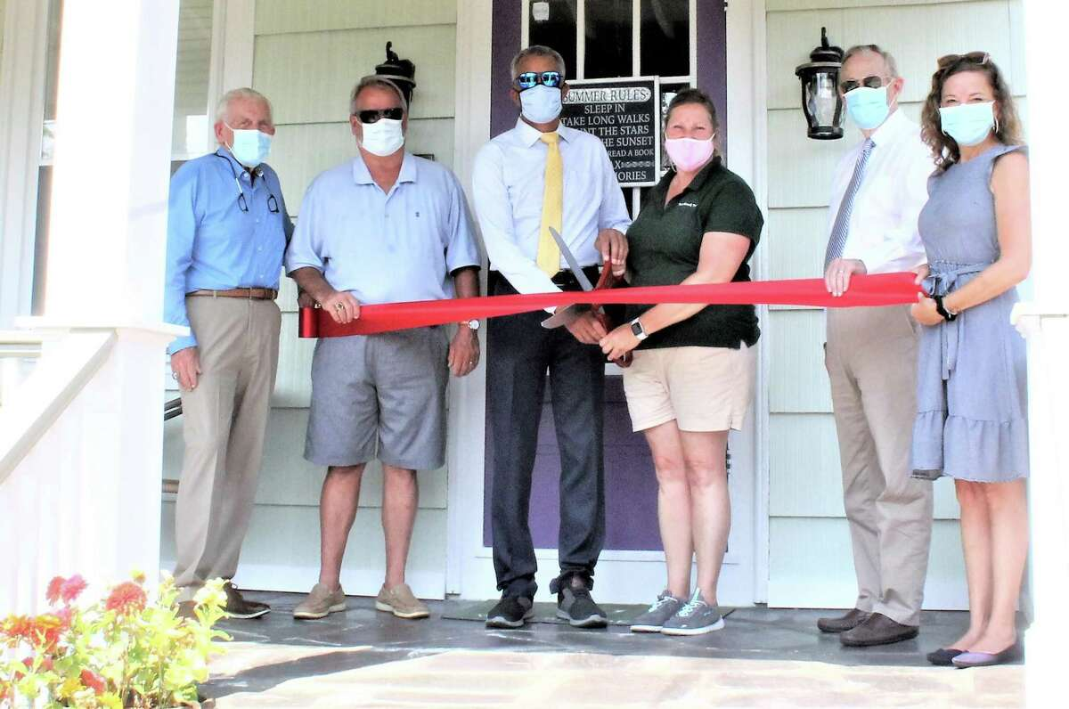 Westbrook Inn Bed & Breakfast, now under new ownership, recently celebrated it grand opening. From left are Middlesex County Chamber of Commerce President Larry McHugh, Westbrook Economic Development Commissioner Jim Crawford, owners Marcus Little and Meri Wick, First Selectman Noel Bishop and Chamber Vice President Johanna Bond.