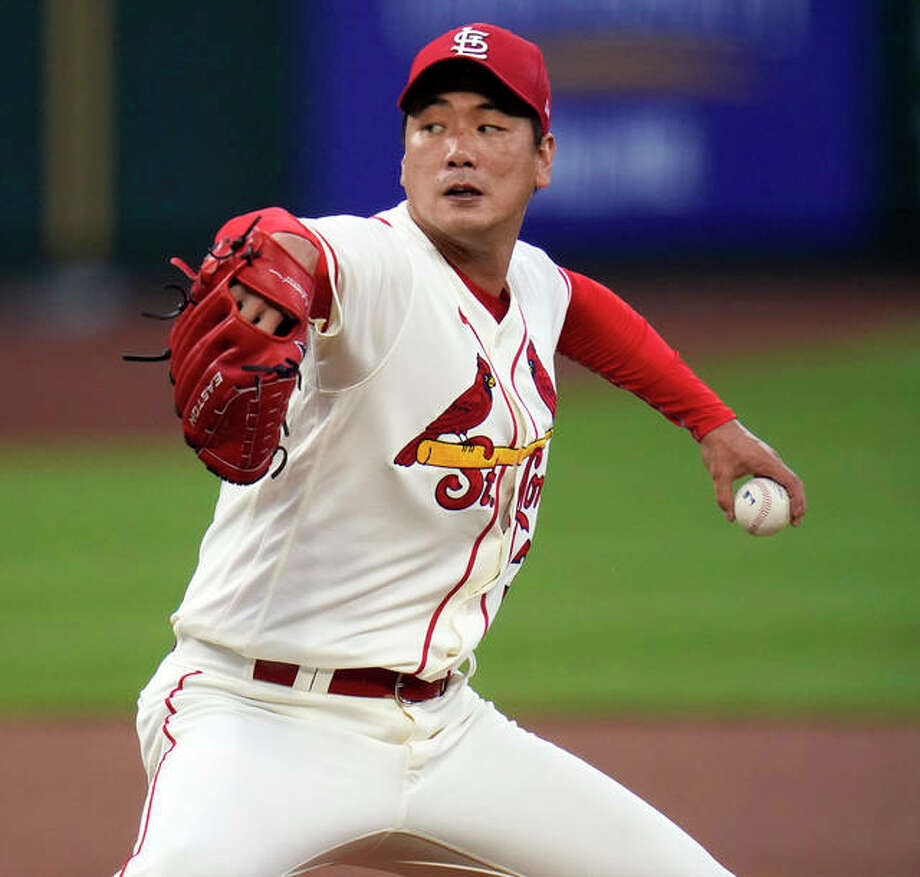 Cardinals starting pitcher Kwang-Hyun Kim throws during the first inning against the Cincinnati Reds on Saturday night at Busch Stadium. Photo: Associated Press