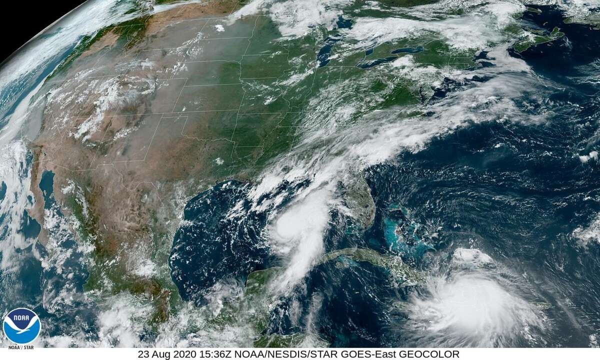 A satellite image shows both tropical storms, Marco and Laura, on the morning of Sunday, Aug. 23.