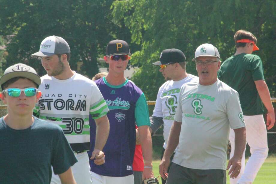 Quad City travel baseball director Dave Yonker (right) led Saturday's tryout session at Win Kellum Field. (Pioneer file photo)