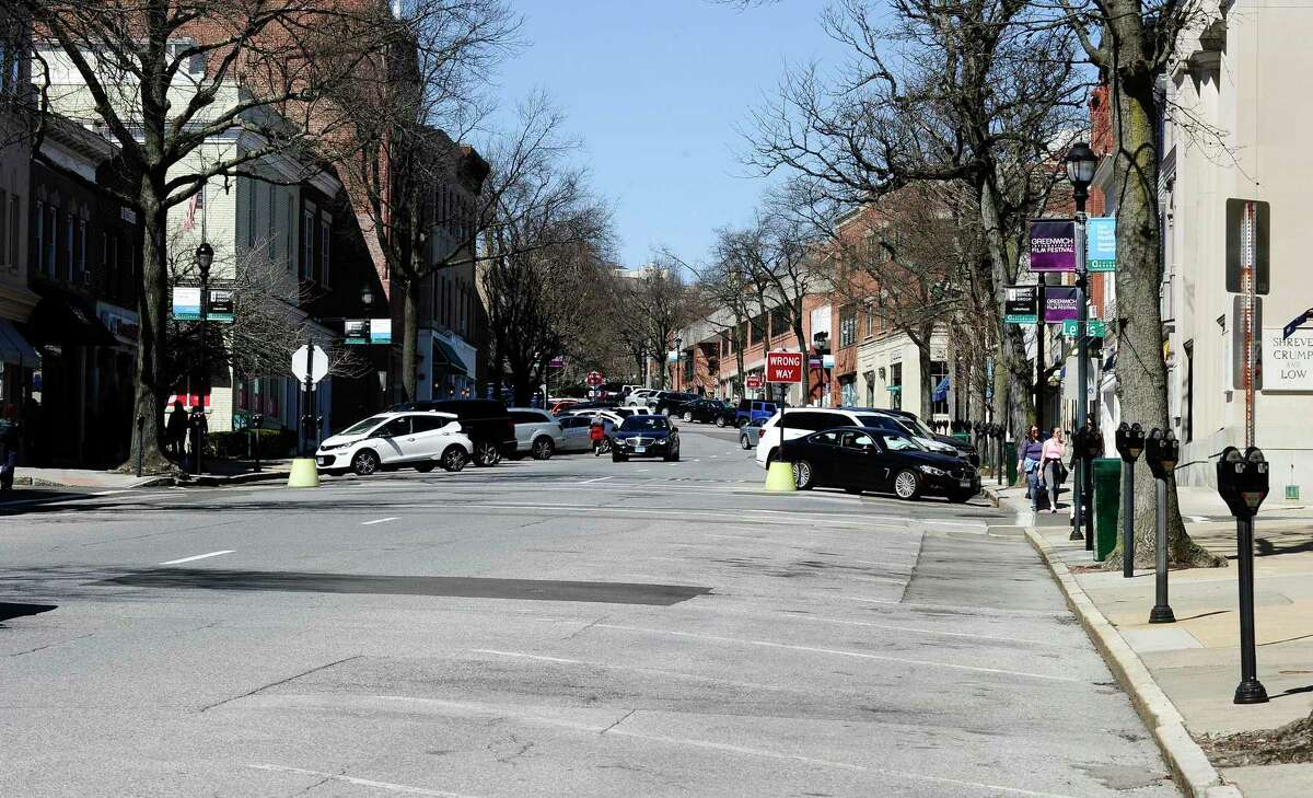 Many businesses along Greenwich Avenue are closed leaving many empty parking spaces available on March 27, 2020 in Greenwich, Connecticut.