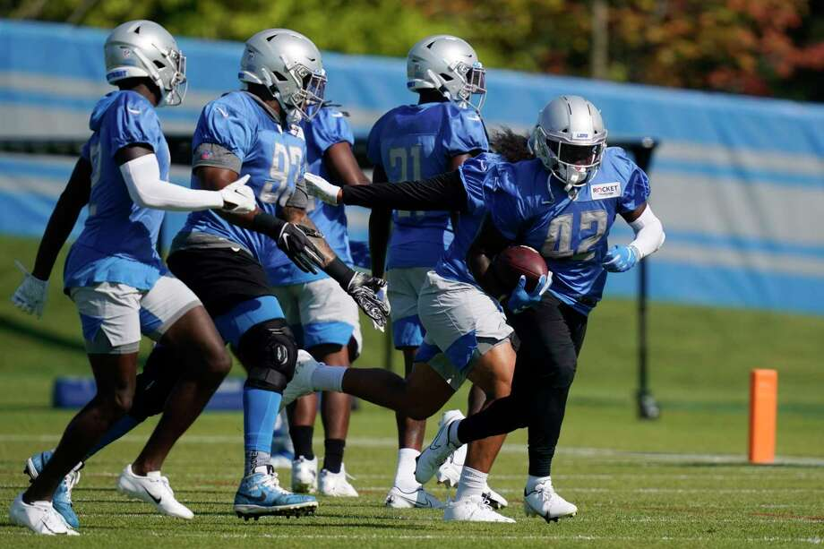 Detroit Lions safety Jalen Elliott (42) runs through a drill at the Lions NFL football camp practice, Saturday in Allen Park, Mich. (AP Photo/Carlos Osorio) / Copyright 2020 The Associated Press. All rights reserved.