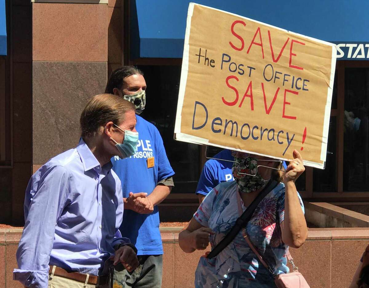 Sen. Richard Blumenthal, D-Conn., was among the speakers at a rally in downtown Hartford to oppose cuts in the U.S. Postal Service. He's shown reacting to another speaker acknowledging him, and talking with a protester.