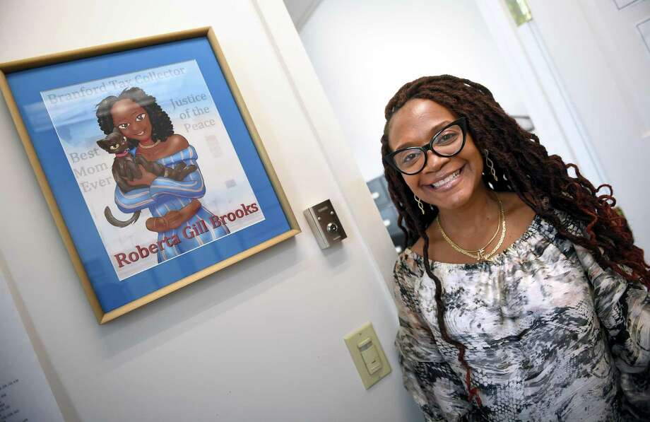 Branford Tax Collector Roberta 'Bobi' Gill-Brooks photographed in her office on Aug. 12 next to a drawing on the wall made by her son. Photo: Arnold Gold / Hearst Connecticut Media / New Haven Register