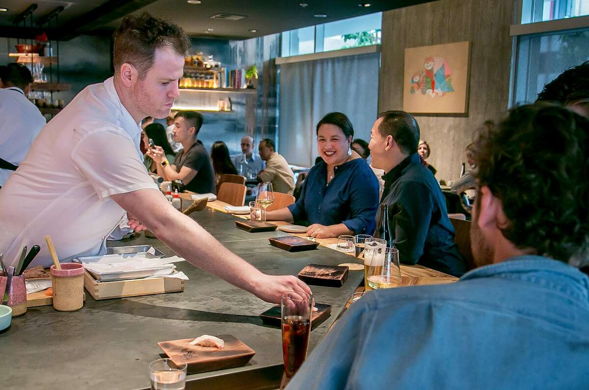Chef Adam Tortosa places sushi on customers plates at Robin in San Francisco, Calif., on September 9th, 2017.