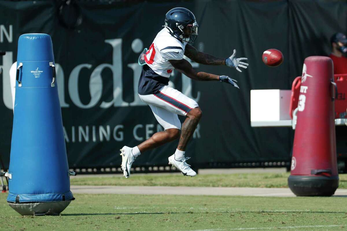 Houston Texans cornerback Cornell Armstrong (30) leaps for a ball during an NFL training camp football practice Sunday, Aug. 23, 2020, in Houston.
