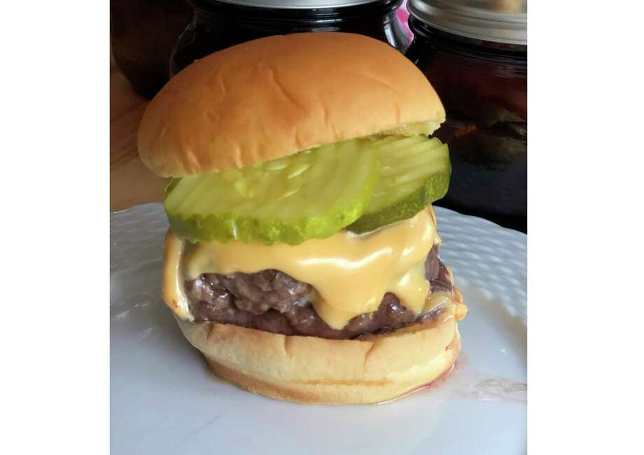 This June 2020 photo shows a cheeseburger topped with pickles in Alexandria, Va. To get the best tasting burger, try making your own blend with better quality cuts of beef. (Elizabeth Karmel via AP) / Elizabeth Karmel