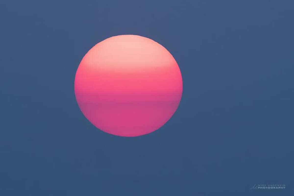 A view of the sun taken late on Aug. 22, 2020 in Dodge City, KS. Wildfire smoke from Northern California as well as Colorado has drifted into the Midwestern region.