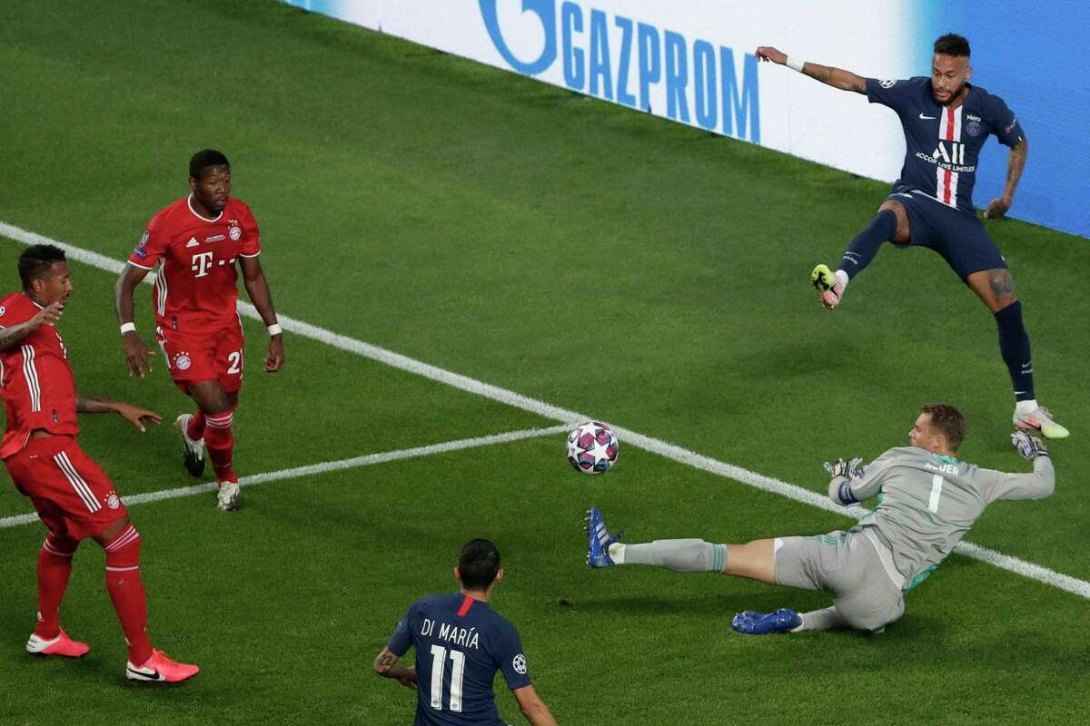 PSG's Neymar, background right, Bayern's David Alaba, second left, Bayern's Jerome Boateng, left, PSG's Angel Di Maria, bottom, and Bayern's goalkeeper Manuel Neuer challenge for the ball during the Champions League final soccer match between Paris Saint-Germain and Bayern Munich at the Luz stadium in Lisbon, Portugal, Sunday, Aug. 23, 2020.