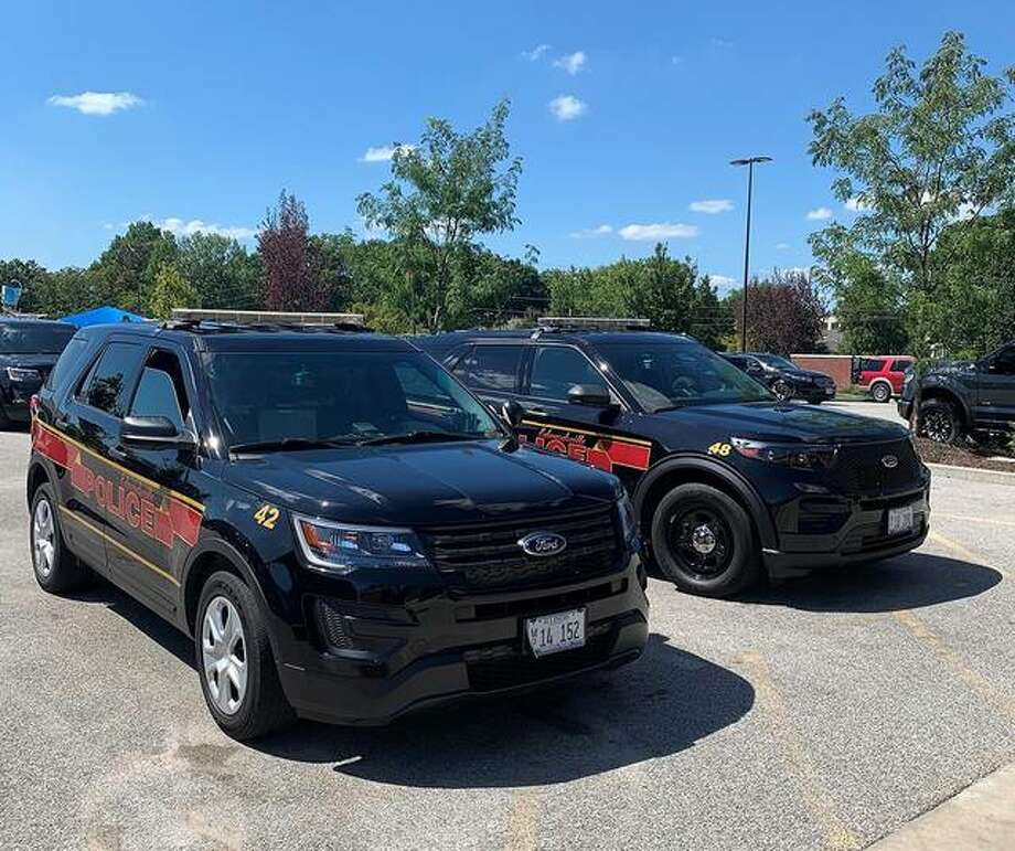 Can you tell the difference between these SUVs? Taxpayers probably would like the SUV in the background better, because it saves about $2,200 in fuel costs each year. Photo: Courtesy Of The Edwardsville Police Department