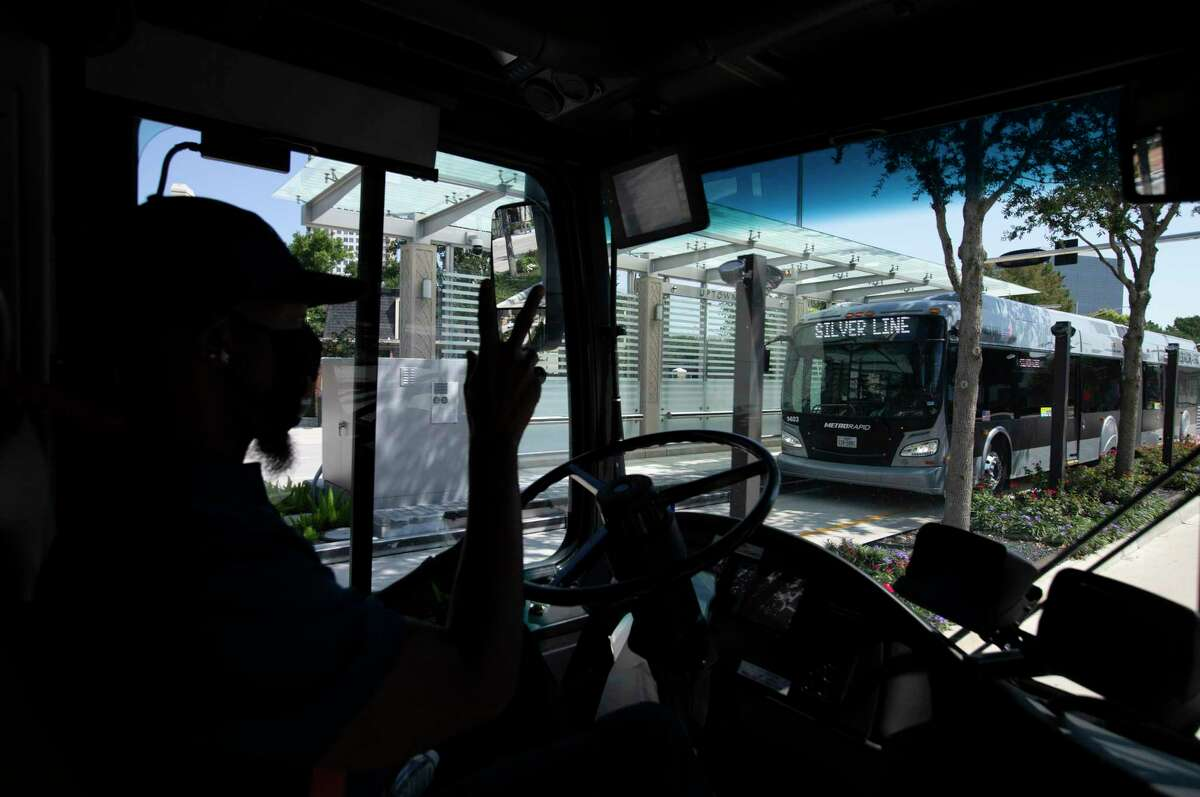 Johnny Finley Jr. waves at the driver on the opposite direction as he is driving the Silver Line bus rapid transit bus on Post Oak Boulevard Sunday, Aug. 23, 2020, in Houston. The line is Houston's first foray into bus rapid transit, with vehicles using mostly dedicated lanes to ferry riders from the new Lower Uptown Westpark Transit Center south of Interstate 69 along Post Oak and eventually to the Northwest Transit Center at Loop 610 and Interstate 10, with eight stops in between.