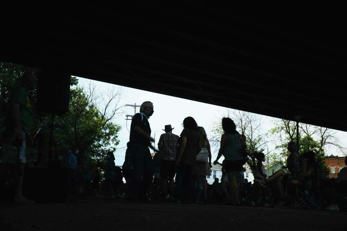 People dance as the band The Accents performs under the Collar City Bridge as part of the Gig 20 concert series on Sunday, Aug. 23, 2020, in Green Island, N.Y. The concert was moved under the bridge due to the heat and the chance of thunderstorms. (Paul Buckowski/Times Union)