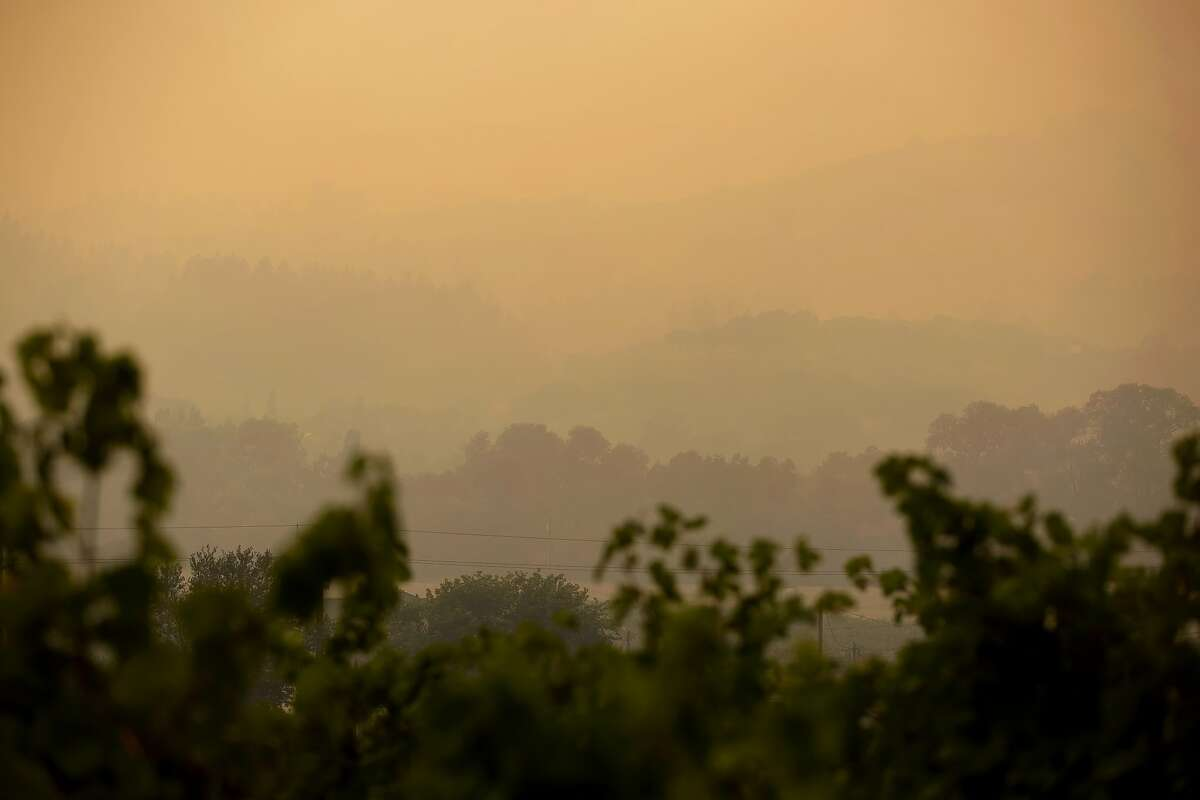 The hills opposite Dry Creek Road are barely seen through the smoke in Healdsburg, Calif. during the Walbridge fire on Saturday, August 22, 2020.