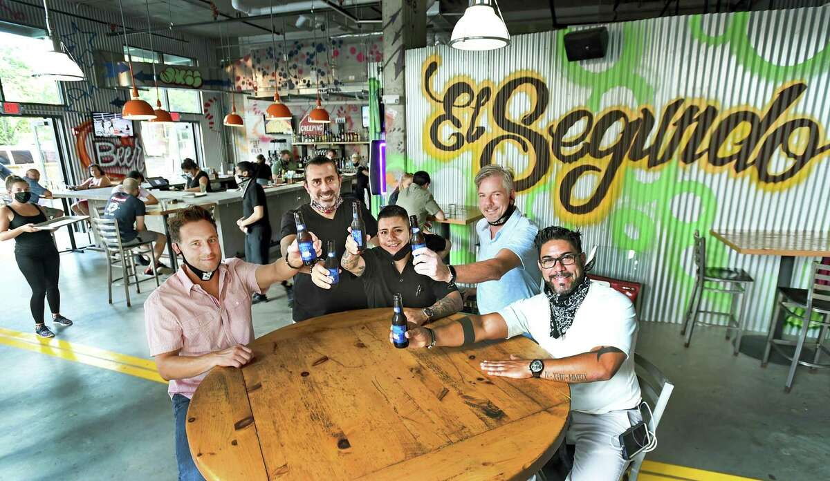 New Haven, Connecticut - Friday, August 21, 2020: Owners of El Segundo restaurant on Orange Street in New Haven that specializes in international street food, from left to right: Chris Rasile, Shawn Longyear, Carlos Baez, Chris Hickey, and Andrey Cortes.