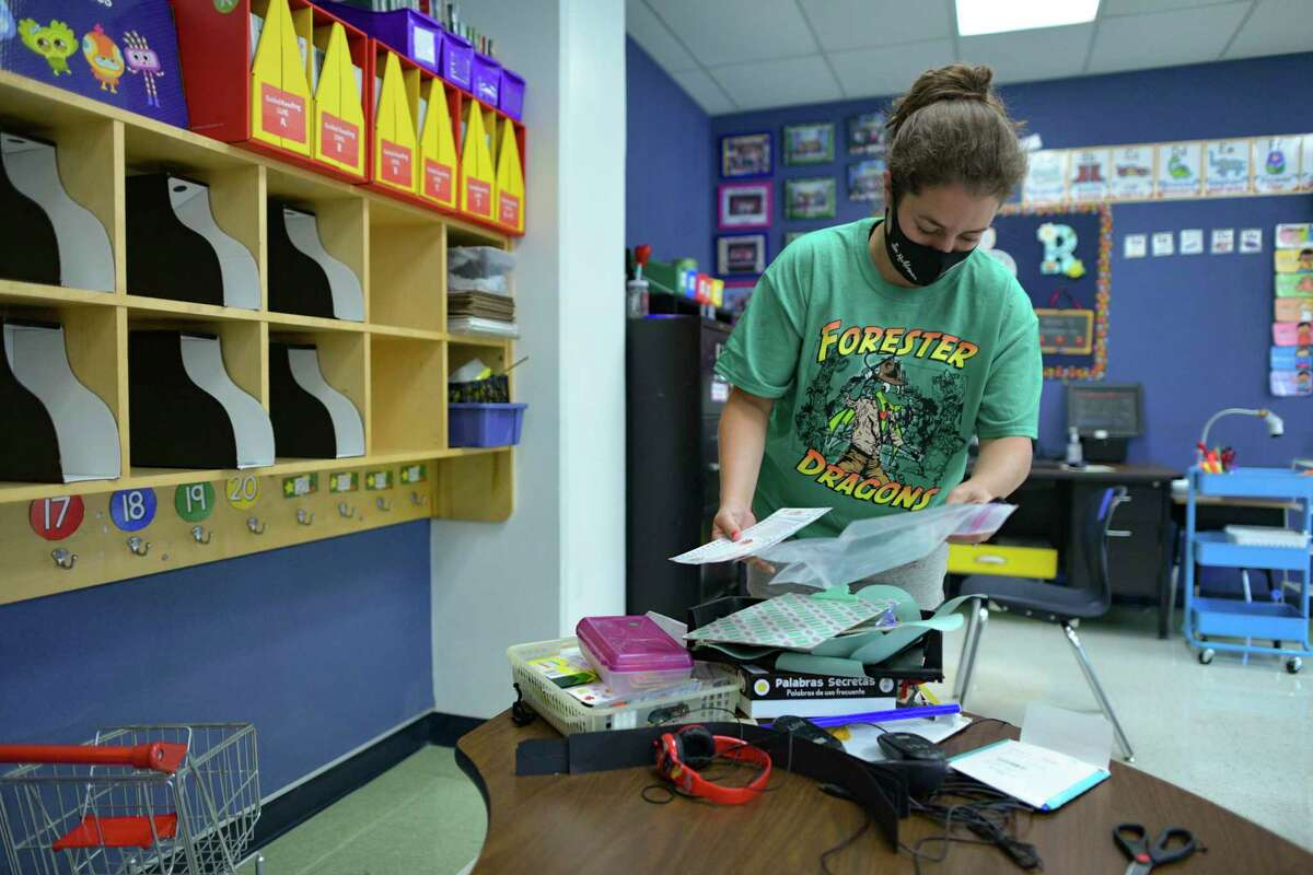 Teacher Gina Rechterman, who teaches kindergarten dual language, sets up her classroom at Forester Elementary School. About 30 percent of the nearly 900 students at the Far West Side school are bilingual.