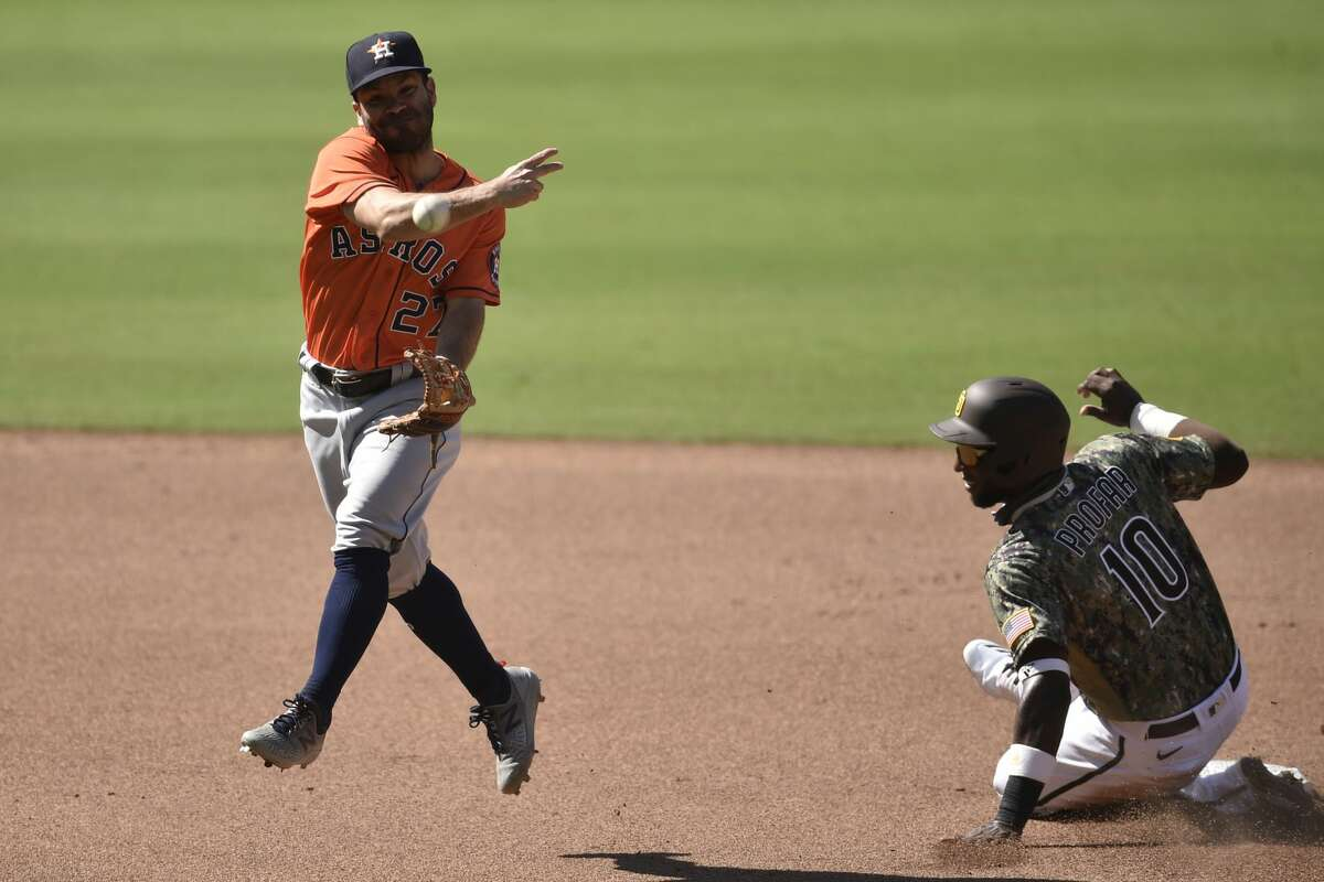 Houston Astros second baseman Jose Altuve, left, throws to first after forcing out San Diego Padres' Jurickson Profar at second base during the seventh inning of a baseball game in San Diego, Sunday, Aug. 23, 2020. Ty France was safe at first base. (AP Photo/Kelvin Kuo)