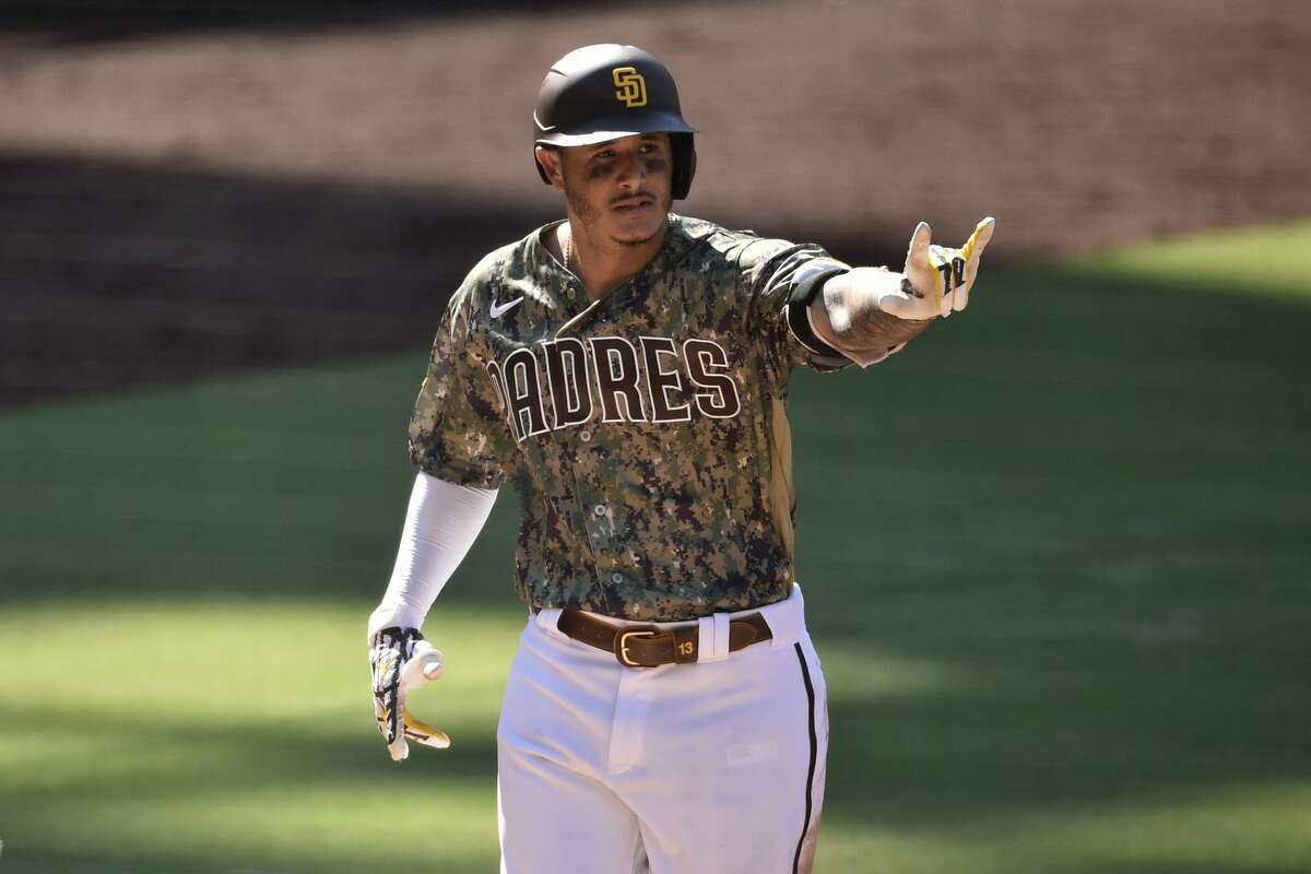 San Diego Padres' Manny Machado celebrates while crossing home on a two-run home run during the eighth inning of a baseball game against the Houston Astros in San Diego, Sunday, Aug. 23, 2020. (AP Photo/Kelvin Kuo)