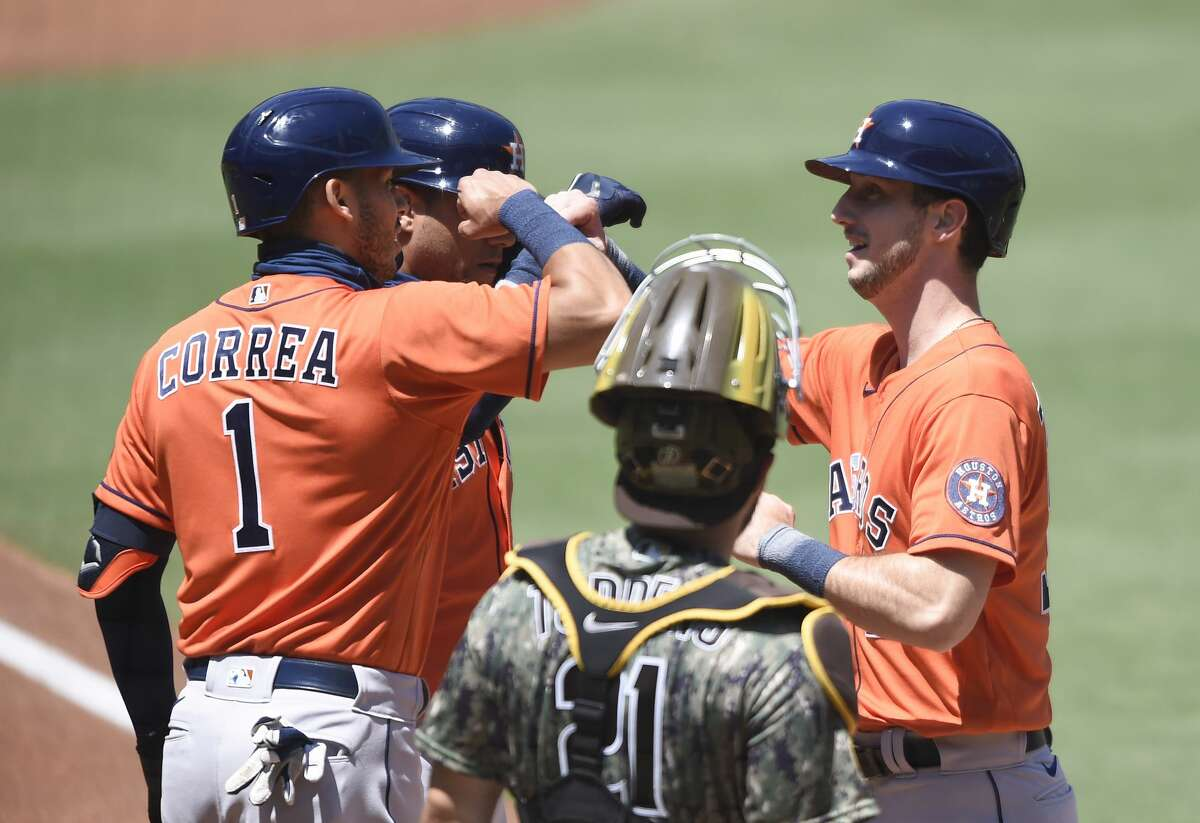 SAN DIEGO, CA - AUGUST 23: Kyle Tucker #30 of the Houston Astros, right, is congratulated by Carlos Correa #1 after hitting a two-run home run during the first inning of a baseball game against the San Diego Padres at Petco Park on August 23, 2020 in San Diego, California. (Photo by Denis Poroy/Getty Images)