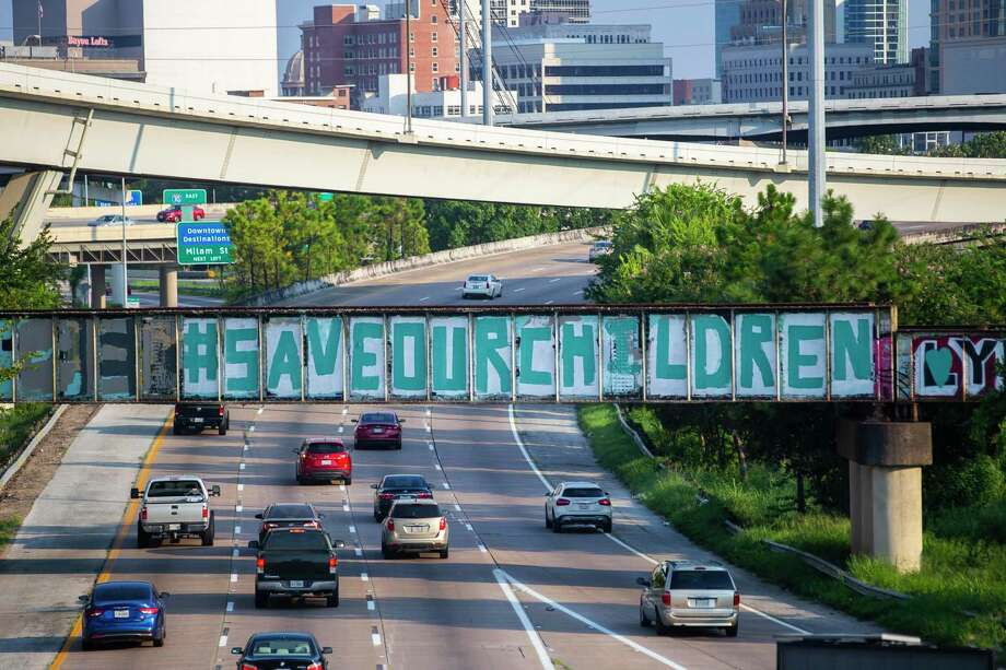 """The """"BeSomeone"""" graffiti near downtown appears painted over with the phrase """"#saveourchildren,"""" Sunday, Aug. 23, 2020, in Houston. Photo: Mark Mulligan, Houston Chronicle / Staff Photographer / © 2020 Mark Mulligan / Houston Chronicle"""