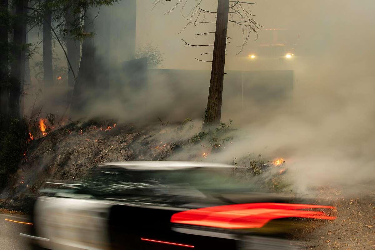 The CZU Lightning Complex Fire burns along Highway 9 near Boulder Creek, Calif. on Aug., 23, 2020.