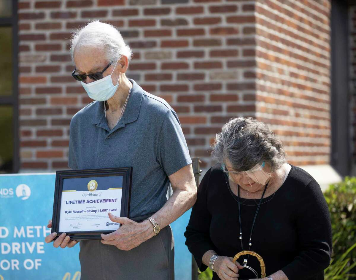 Kevin and Janet Russell bow their heads in prayer at The Woodlands United Methodist Church, Sunday, Aug. 23, 2020. Kevin was honored for his volunteer work with the church and the Gulf Coast Regional Blood Bank.