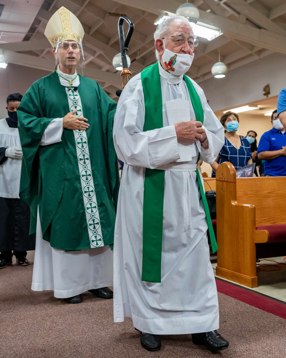 Ninety-nine-year-old pastor of Cristo Rey, Fr. Luis Urizza processes in to his church with the Bishop. Newly-ordained Bishop David Toups celebrated Mass in Spanish with the parishioners of Cristo Rey in Beaumont on Sunday evening. Photo made on August 23, 2020. Fran Ruchalski/The Enterprise