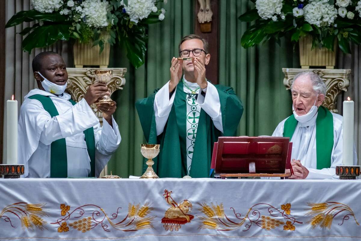 Newly-ordained Bishop David Toups concelebrated Mass in Spanish with Fr. Samuel Moses, left, and Pastor Luis Urizza for the parishioners of Cristo Rey in Beaumont on Sunday evening. Photo made on August 23, 2020. Fran Ruchalski/The Enterprise