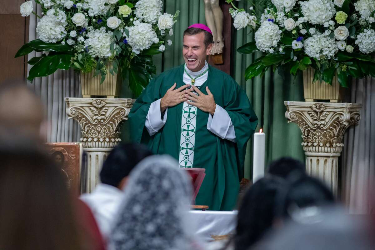 The Bishop chats with the parishioners in Spanish as he says Mass. Newly-ordained Bishop David Toups celebrated Mass in Spanish with the parishioners of Cristo Rey in Beaumont on Sunday evening. Photo made on August 23, 2020. Fran Ruchalski/The Enterprise