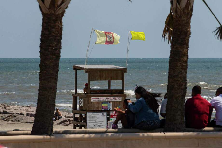 Wind blows the flags on a life guard station near the Pleasure Pier on Sunday, Aug. 23, 2020. Laura was upgraded to a hurricane Tuesday morning. Photo: Mark Mulligan, Houston Chronicle / Staff Photographer / © 2020 Mark Mulligan / Houston Chronicle