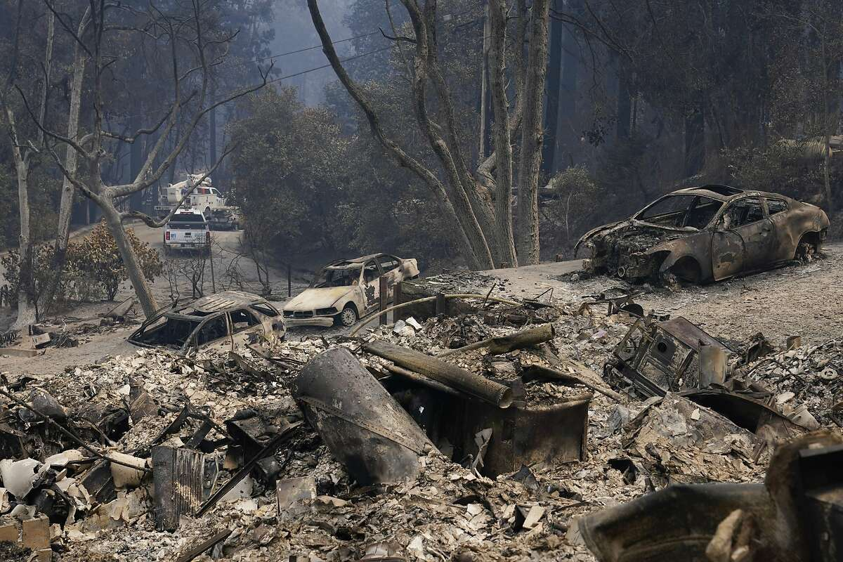 Burned vehicles and a rubble from homes are left after the CZU Lightning Complex Fire went through Sunday, Aug. 23, 2020, in Boulder Creek, Calif. (AP Photo/Marcio Jose Sanchez)