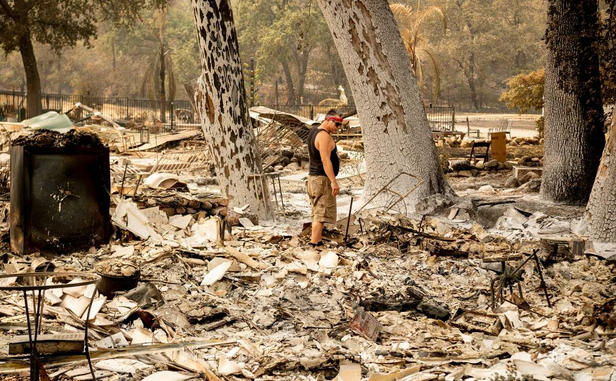 Resident Cliff Giannuzzi looks over the charred remains of his home during the LNU Lightning Complex fire in Vacaville, California on August 23, 2020. - Firefighters battled some of California's largest-ever fires that have forced tens of thousands from their homes and burned one million acres, with further lightning strikes and gusty winds forecast in the days ahead.