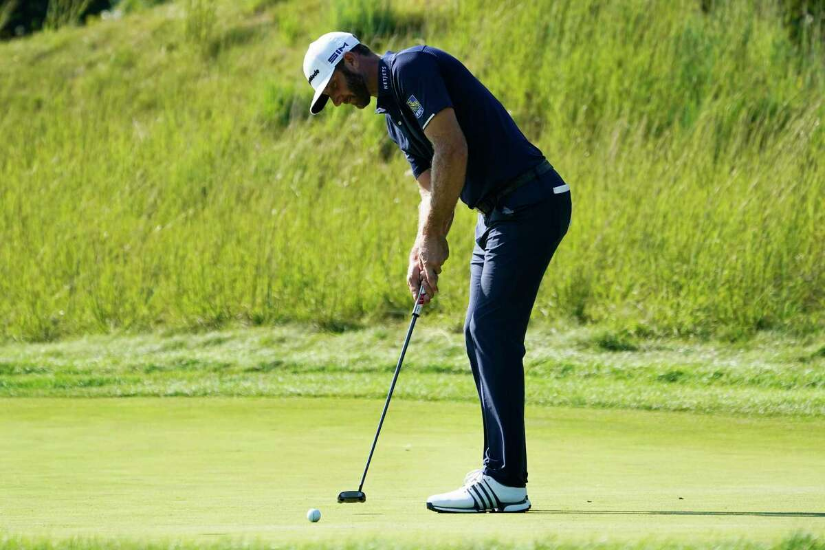 Dustin Johnson putts on the eighth hole during the final round of the Northern Trust golf tournament at TPC Boston, Sunday, Aug. 23, 2020, in Norton, Mass. (AP Photo/Charles Krupa)