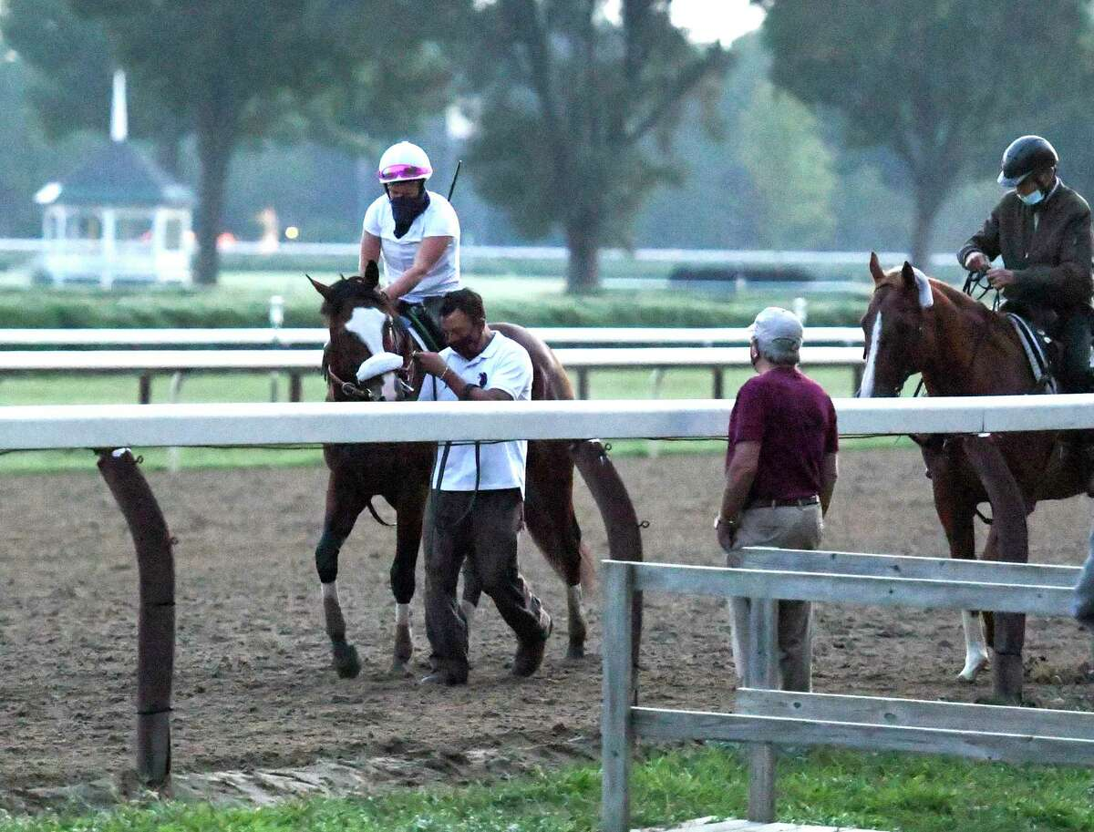 As Jack Knowlton, managing partner of Sackatoga Stables watches from the side of the track Tiz the Law with exercise rider Heather Smullen aboard returns to the barn after one of his final preparatory works before the Kentucky Derby Sunday Aug.23, 2020 at the Saratoga Race Course in Saratoga Springs, N.Y. Photo by Skip Dickstein/Special to the Times Union