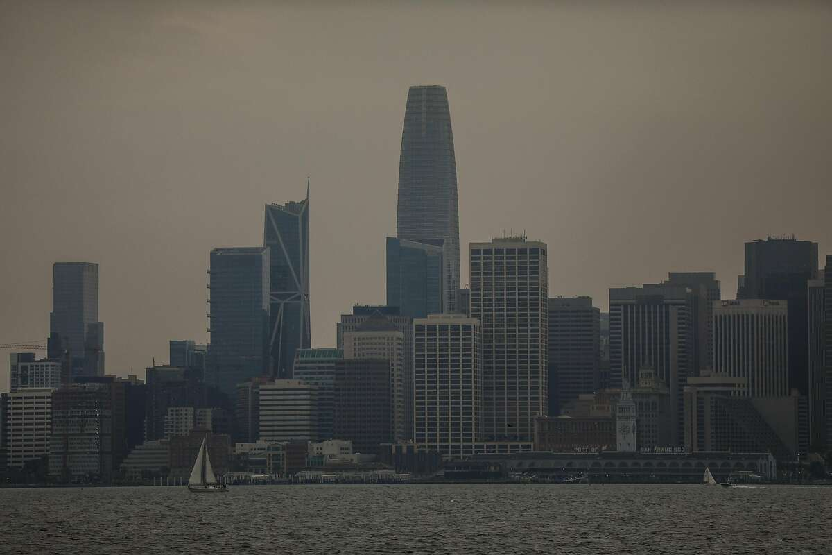 Haze and smoke surround the San Francisco skyline as seen from Treasure Island on Sunday, Aug. 23, 2020 in San Francisco, California. The fires in Northern California have made the air quality bad in the Bay Area.