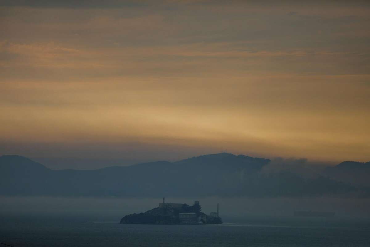 Haze and smoke surround Alcatraz as seen from Treasure Island on Sunday, Aug. 23, 2020 in San Francisco, California. The fires in Northern California have made the air quality bad in the Bay Area.