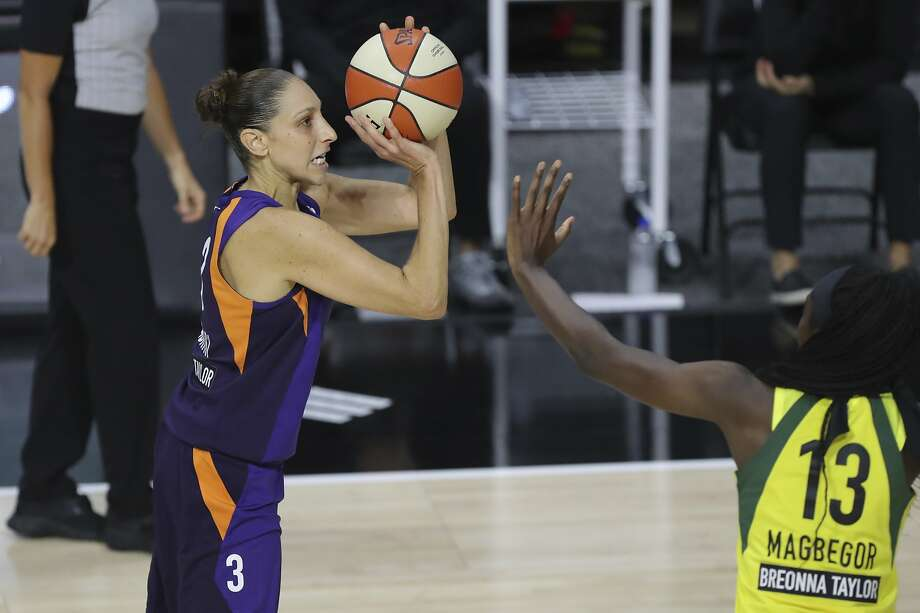 Phoenix Mercury's Diana Taurasi, left, shoots over the defense of Seattle Storm's Ezi Magbegor, right, during the first half of a WNBA basketball game Saturday, Aug. 8, 2020, in Bradenton, Fla. (AP Photo/Mike Carlson) Photo: Mike Carlson / Associated Press