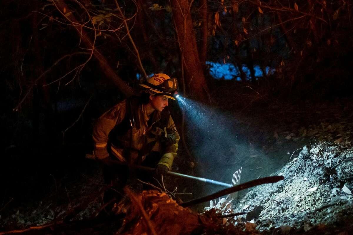 Cal Fire firefighter Bianca Romeo cuts fire line to control the CZU Lightning Complex Fire near Boulder Creek, Calif. on Aug., 23, 2020.