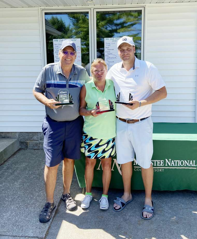 Pictured (from left) are Mike O'Branovich, Julie Brakora and Zack Bialik with their respective club championship trophies at Manistee National Golf and Resort. (Courtesy photo) Photo: Courtesy Photo
